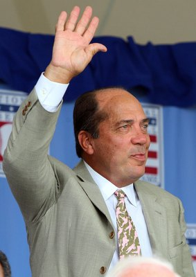 COOPERSTOWN, NY - JULY 26:  Hall of Famer Johnny Bench waves to the crowd as he is introduced at Clark Sports Center during the 2009  Baseball Hall of Fame induction ceremony on July 26, 2009 in Cooperstown, New York.  (Photo by Jim McIsaac/Getty Images)
