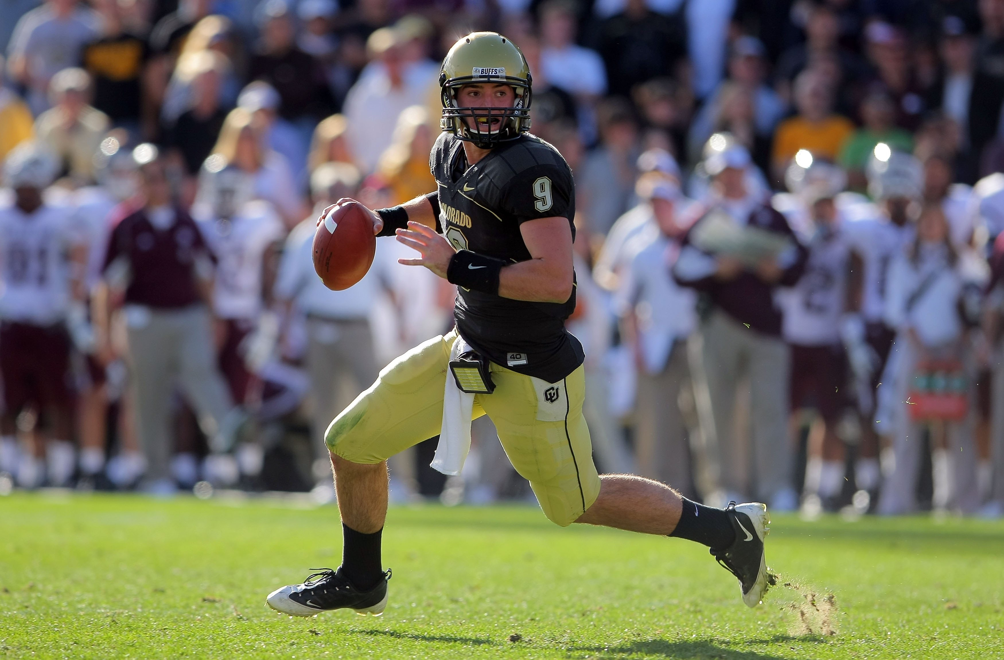 BOULDER, CO - NOVEMBER 07:  Quarterback Tyler Hansen #9 of the Colorado Buffaloes rolls out to deliver a pass against the Texas A&M Aggies during NCAA college football action at Folsom Field on November 7, 2009 in Boulder, Colorado. Colorado defeated Texa