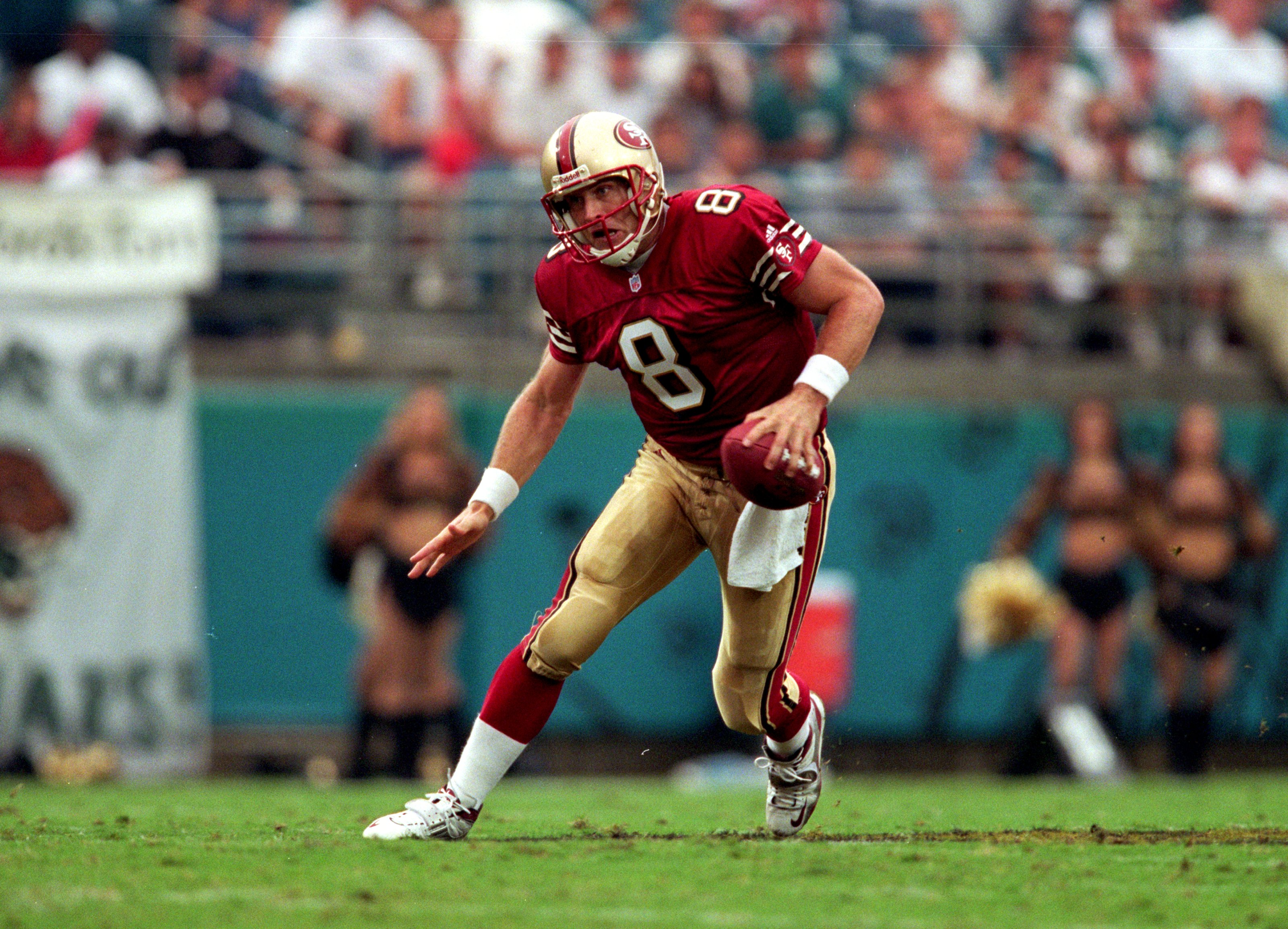12 Sep 1999:  Steve Young #8 of the San Francisco 49ers moves with the ball during the game against the Jacksonville Jaguars at the Alltell Stadium in Jacksonville, Florida. The Jaguars defeated the 49ers 41-3. Mandatory Credit: Andy Lyons  /Allsport