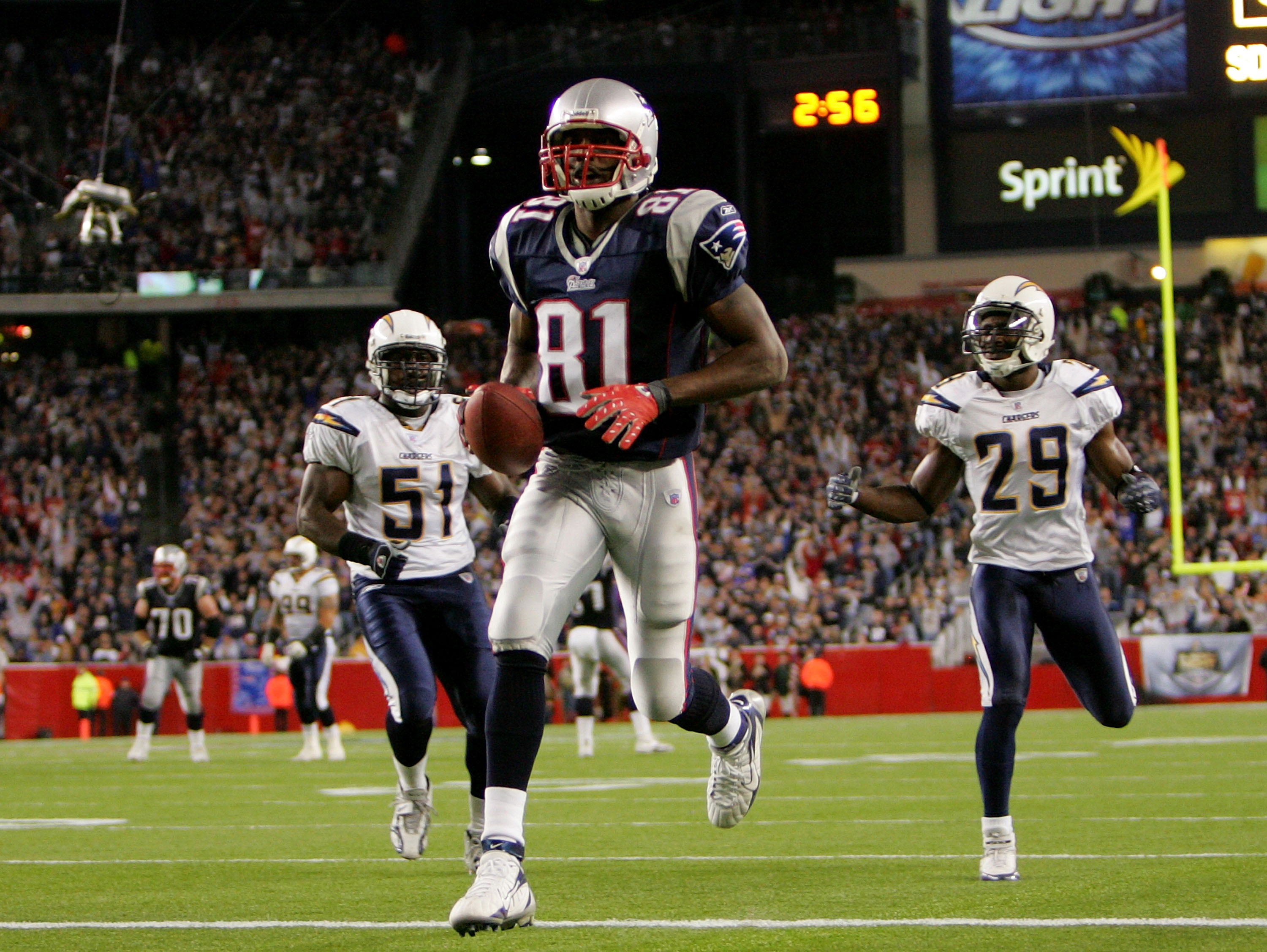 FOXBORO, MA - SEPTEMBER 16:  Randy Moss #81 of the New England Patriots scores a touchdown against the San Diego Chargers during their game at Gillette Stadium September 16, 2007 in Foxboro, Massachusetts.  (Photo by Nick Laham/Getty Images)