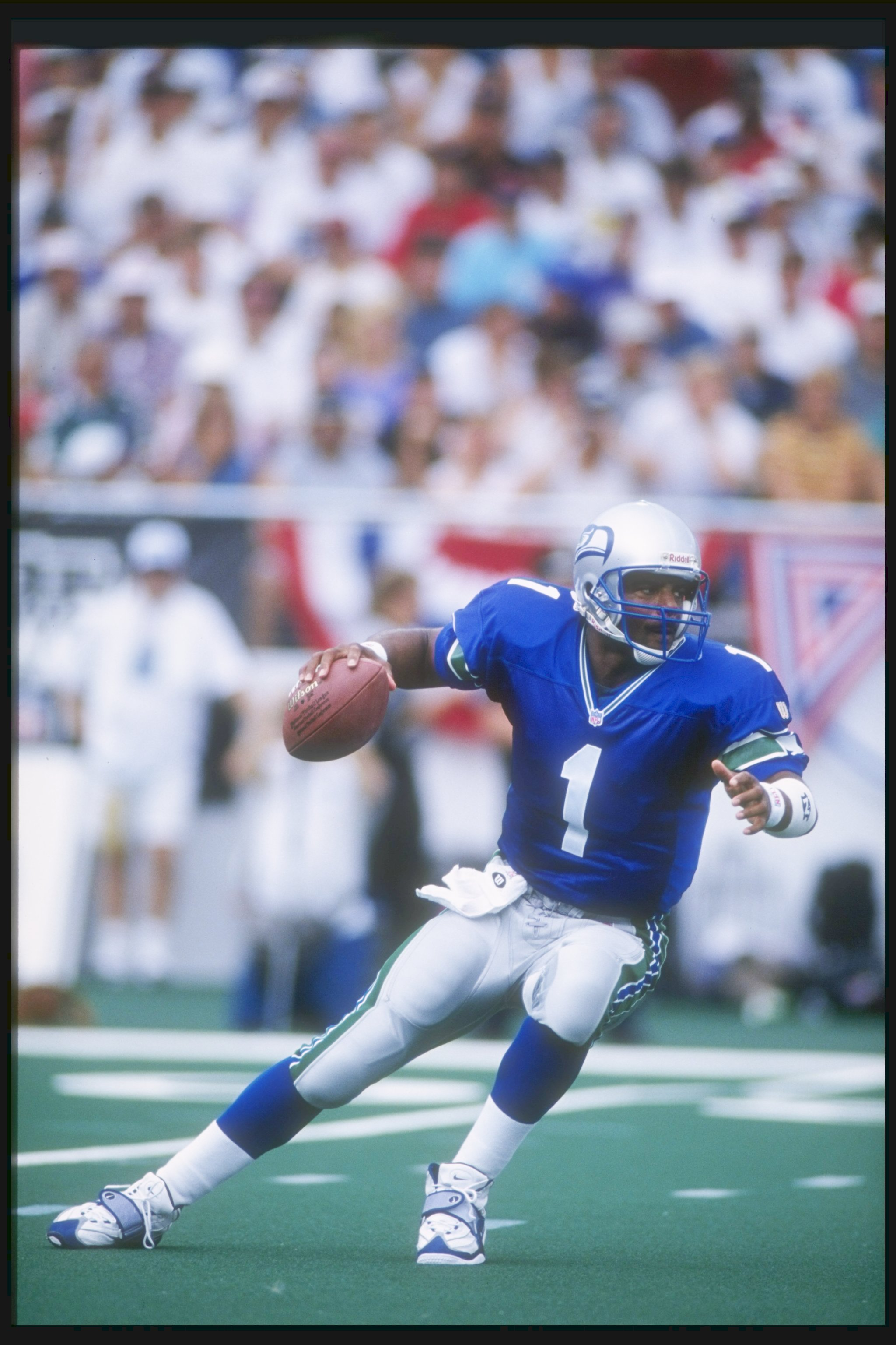 26 Jul 1997:  Quarterback Warren Moon of the Seattle Seahawks looks to pass the ball during the Hall of Fame game against the Minnesota Vikings at Fawcett Stadium in Canton, Ohio.  The Vikings won the game, 28-26. Mandatory Credit: Matthew Stockman  /Alls