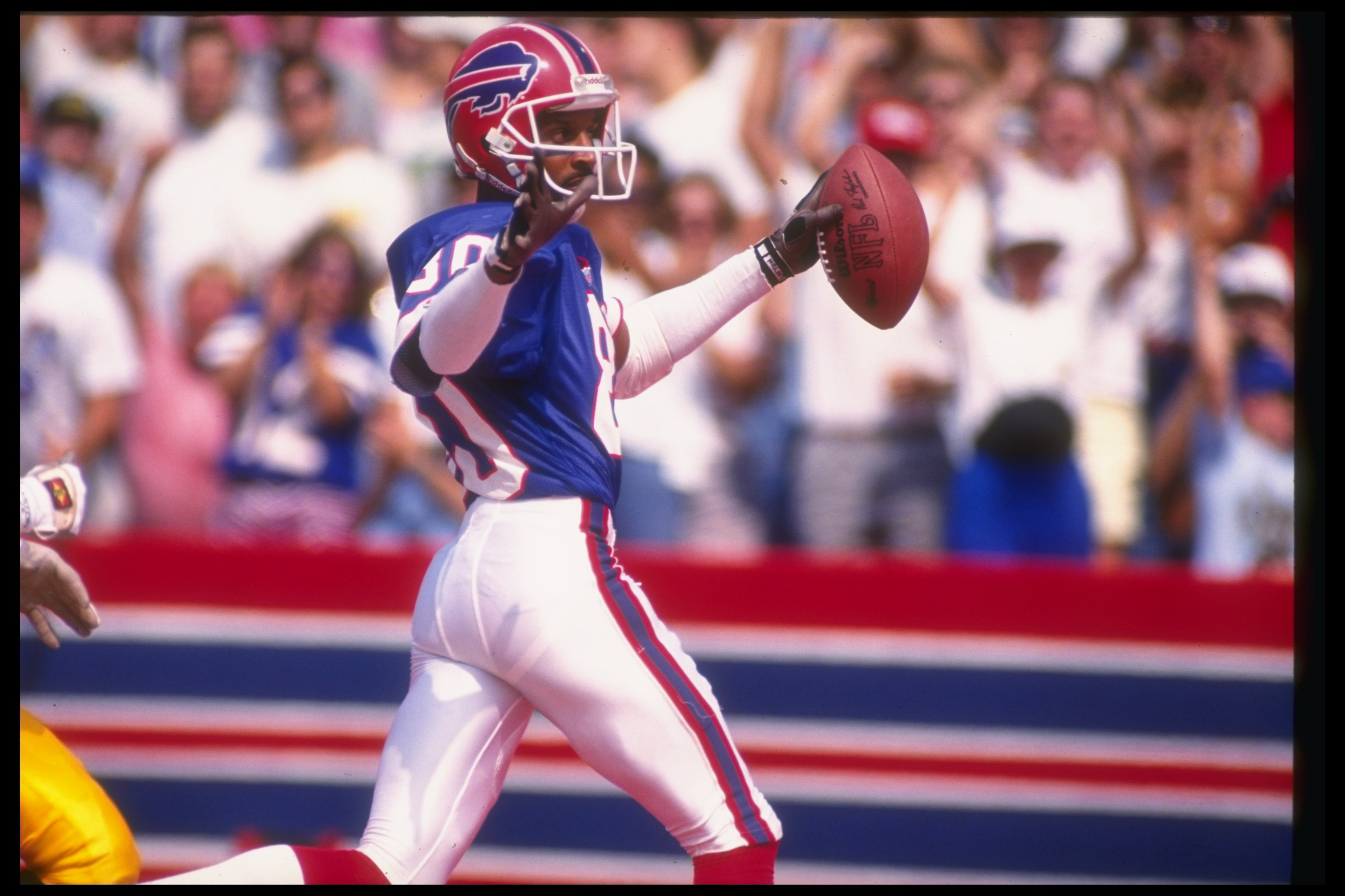 8 Sep 1991: Wide receiver James Lofton of the Buffalo Bills scores a touchdown during a game against the Pittsburgh Steelers at Rich Stadium in Orchard Park, New York. The Bills won the game, 52-34.