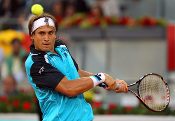 MADRID, SPAIN - MAY 03:  David Ferrer of Spain in action in his match against Adrian Mannarino of France during day four of the Mutua Madrilena Madrid Open Tennis on May 3, 2011 in Madrid, Spain.  (Photo by Julian Finney/Getty Images)
