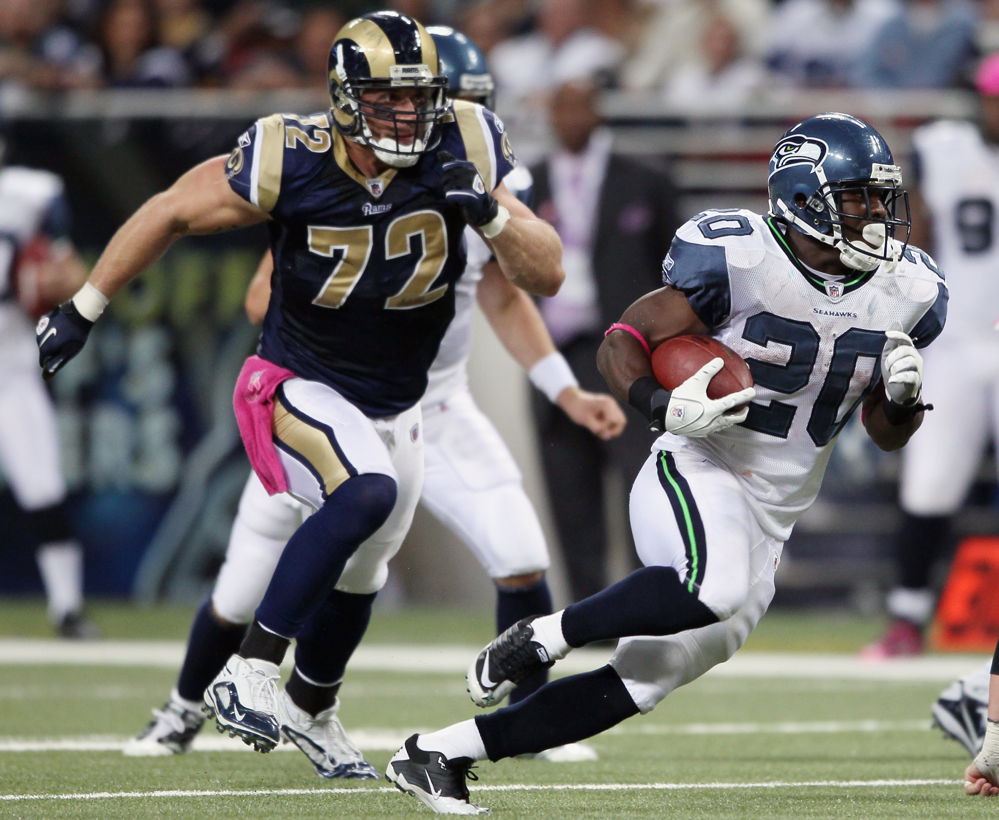 ST. LOUIS - OCTOBER 03:  Justinn Forsett #20 of the Seattle Seahawks carries the ball as Chris Long #72 of the St. Louis Rams defends on October 3, 2010 at Edward Jones Dome in St. Louis, Missouri.  (Photo by Elsa/Getty Images)