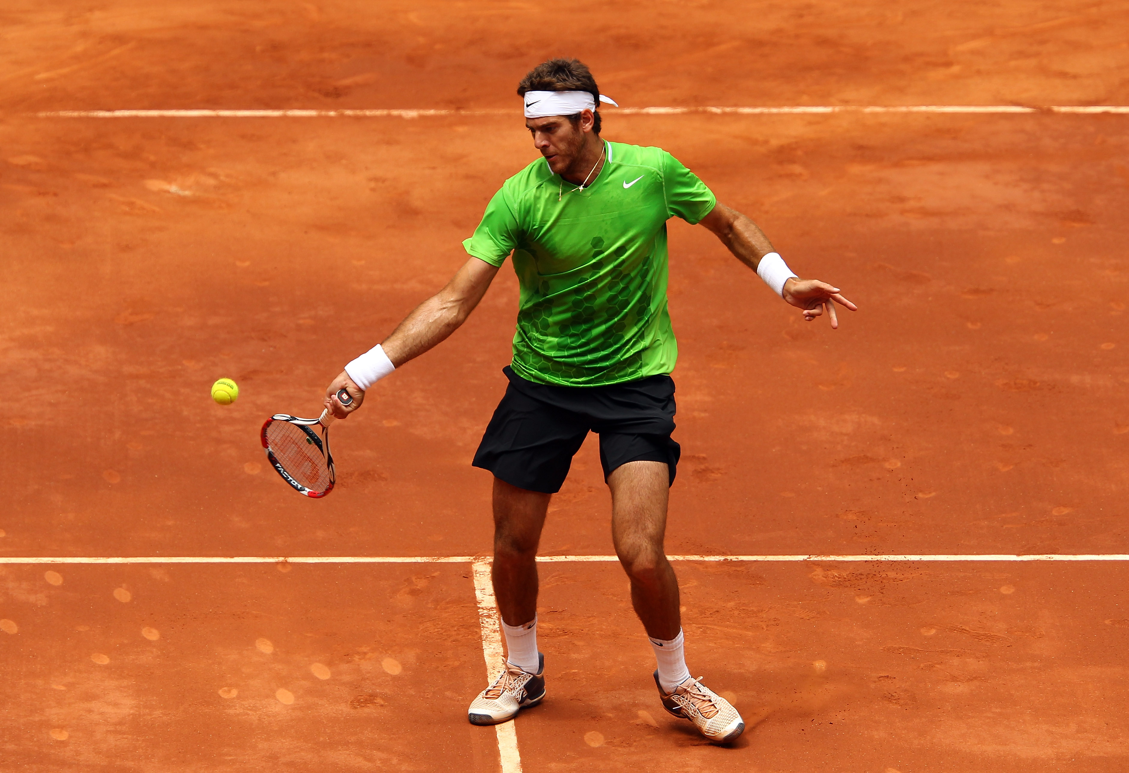 MADRID, SPAIN - MAY 03:  Juan Martin Del Potro of Argentina plays a forehand in his match against Mikhail Youzhny of Russia during day four of the Mutua Madrilena Madrid Open Tennis on May 3, 2011 in Madrid, Spain.  (Photo by Julian Finney/Getty Images)