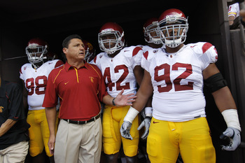 HONOLULU - SEPTEMBER 02:  Defensive and Recruiting Coordinator Ed Orgeron of the University of Souther California Trojans leads the team to the edge of the tunnel before the start of the Trojan's season opener against the Hawaii Warriors at Aloha Stadium