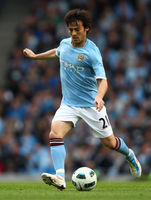MANCHESTER, ENGLAND - MAY 17: David Silva of Manchester City in action during the Barclays Premier League match between Manchester City and Stoke City at City of Manchester Stadium on May 17, 2011 in Manchester, England.  (Photo by Clive Brunskill/Getty I