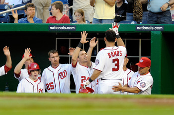 WASHINGTON, DC - APRIL 26:  Wilson Ramos #3 of the Washington Nationals is congratulated by teammates after hitting a home run in the second inning against the New York Mets at Nationals Park on April 26, 2011 in Washington, DC.  (Photo by Greg Fiume/Gett