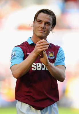 LONDON, ENGLAND - MAY 22:  Scott Parker of West Ham salutes the fans at the end of the Barclays Premier League match between West Ham United and Sunderland at Boleyn Ground on May 22, 2011 in London, England.  (Photo by Mike Hewitt/Getty Images)