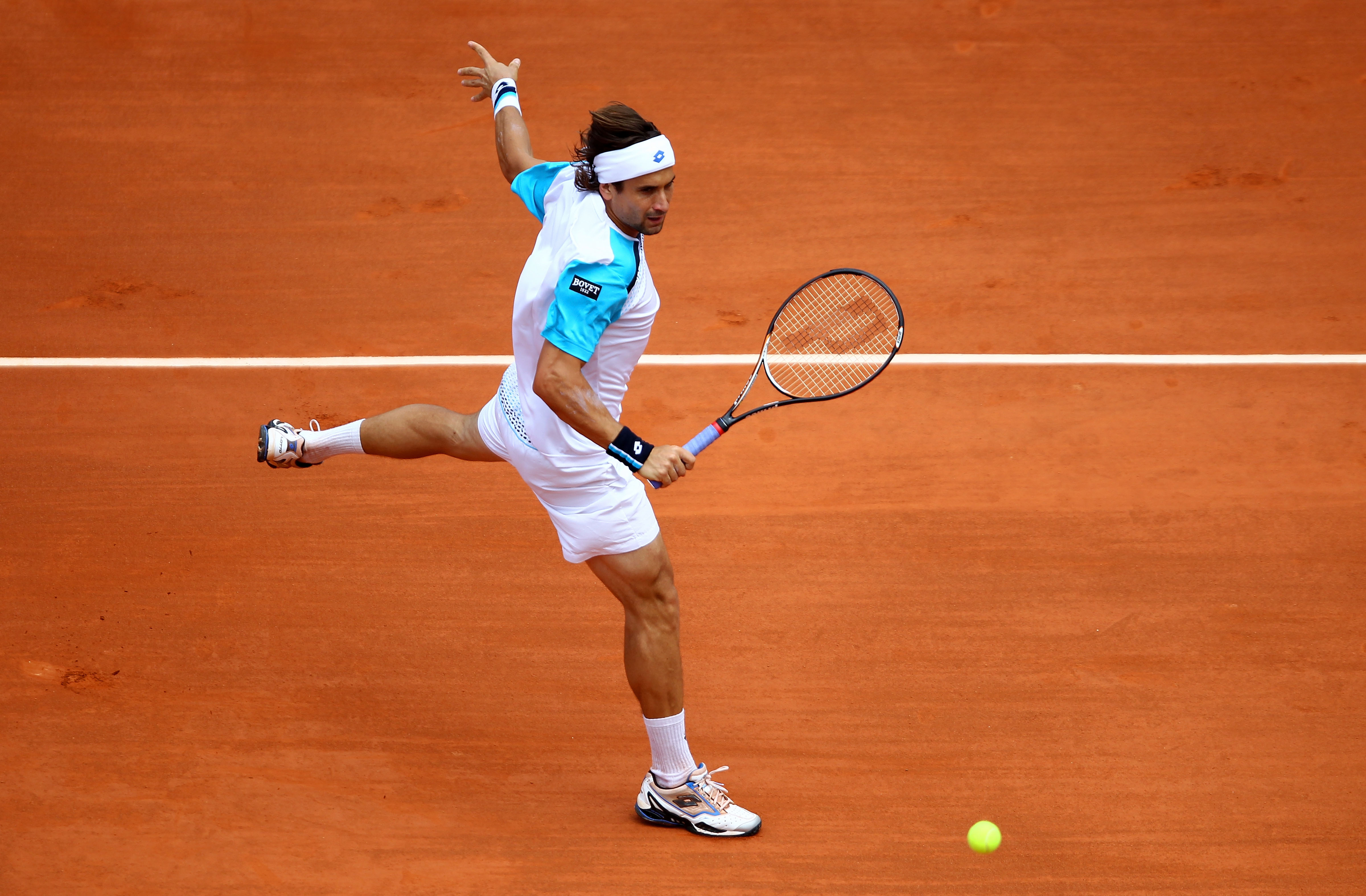 PARIS, FRANCE - MAY 22:  David Ferrer of Spain plays a backhand during the men's singles round one match  between David Ferrer of Spain and Jarkko Nieminen of Finland on day one of the French Open at Roland Garros on May 22, 2011 in Paris, France.  (Photo