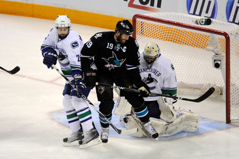 SAN JOSE, CA - MAY 22:   Joe Thornton #19 of the San Jose Sharks screens goaltender Roberto Luongo #1 of the Vancouver Canucks as Dan Hamhuis #2 of the Vancouver Canucks defends the play in the first period in Game Four of the Western Conference Finals du