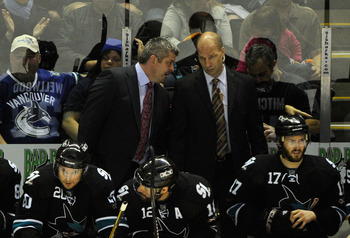 SAN JOSE, CA - MAY 22:  Head Coach Todd McLellan and Assistant Coach Matt Shaw of the San Jose Sharks confer on the benc during Game Four of the Western Conference Finals between the Vancouver Canucks and the San Jose Sharks during the 2011 Stanley Cup Pl