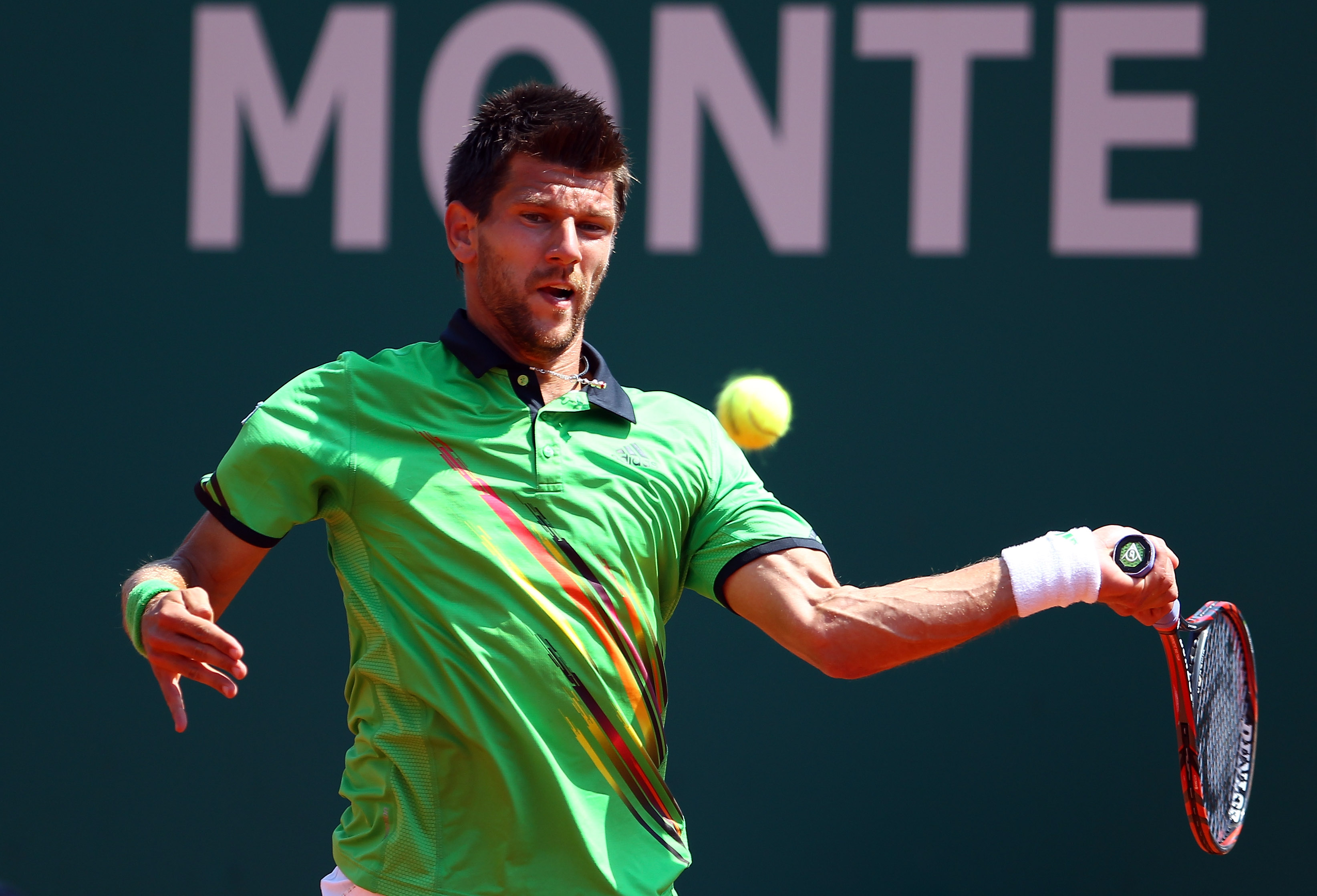 MONACO - APRIL 16:   Jurgen Melzer of Austria plays a forehand in his match against David Ferrer of Spain during Day Seven of the ATP Masters Series Tennis at the Monte Carlo Country Club on April 16, 2011 in Monte Carlo, Monaco.  (Photo by Julian Finney/