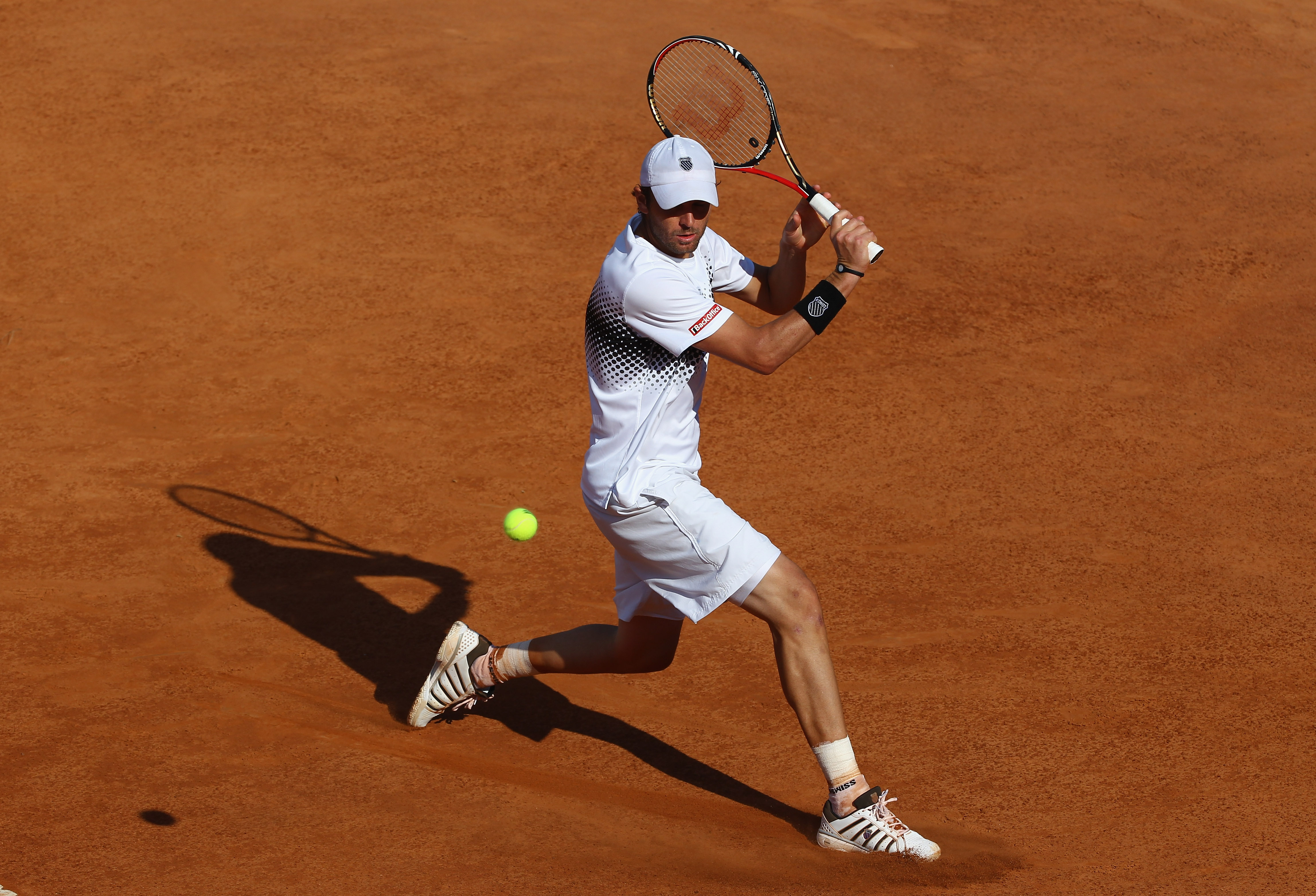 ROME, ITALY - MAY 09:  Mardy Fish of the USA plays a backhand during his first round match against Santiago Giraldo of Columbia during day two of the Internazoinali BNL D'Italia at the Foro Italico Tennis Centre on May 9, 2011 in Rome, Italy.  (Photo by C