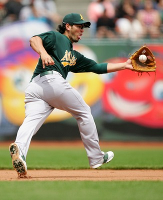 SAN FRANCISCO - JUNE 10:  Eric Chavez #3 of the Oakland Athletics field a ball hit by Matt Cain in the 5th inning against the San Francisco Giants during a Major League Baseball game on June 10, 2007 at AT&T Park in San Francisco, California.  (Photo by J