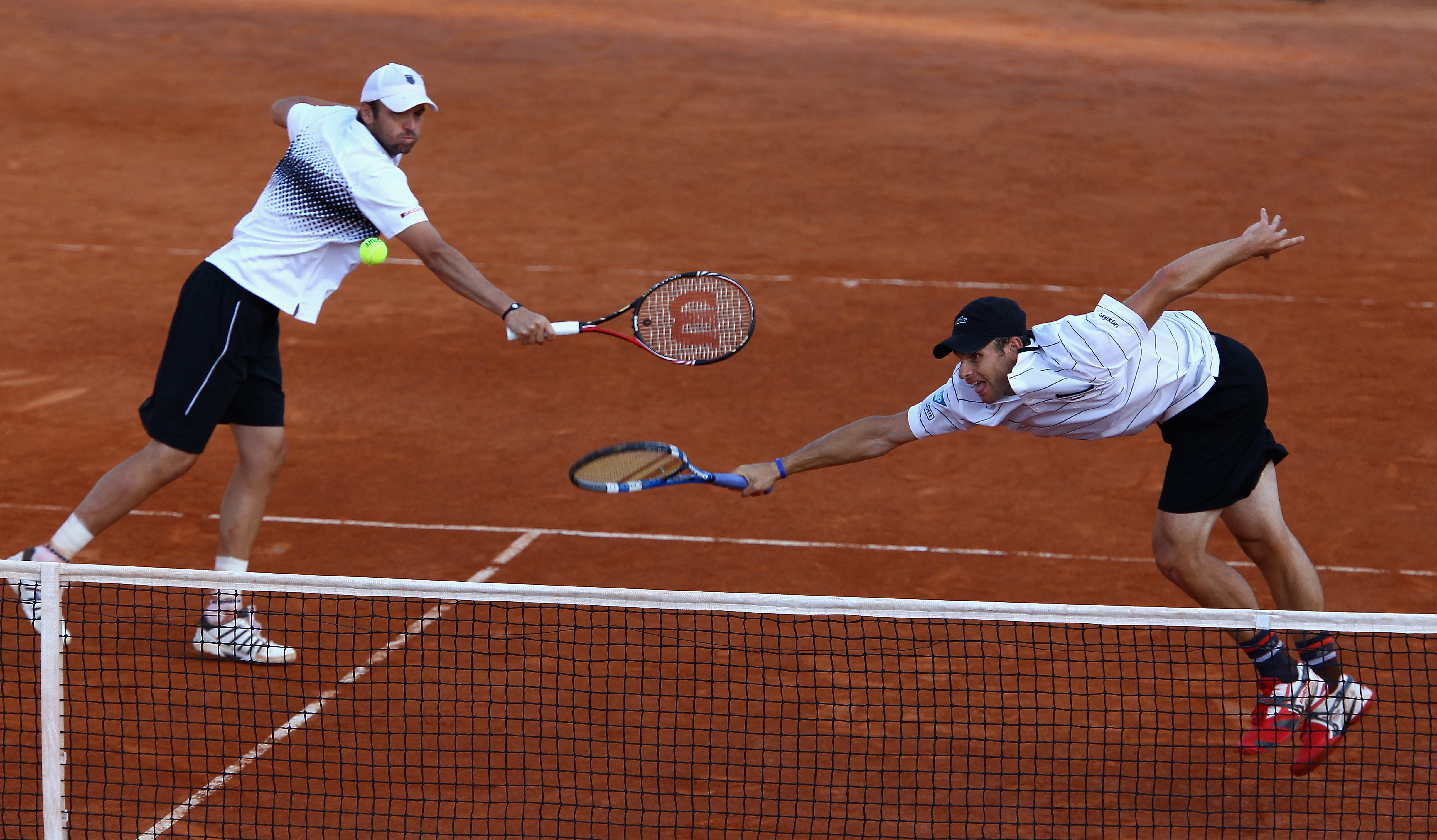 ROME, ITALY - MAY 14:  Andy Roddick and Mardy Fish of the USA in action during their doubles semi final match against Carlos Berlocq of Argentina and Jarkko Nieminen of Finland during day seven of the Internazoinali BNL D'Italia at the Foro Italico Tennis