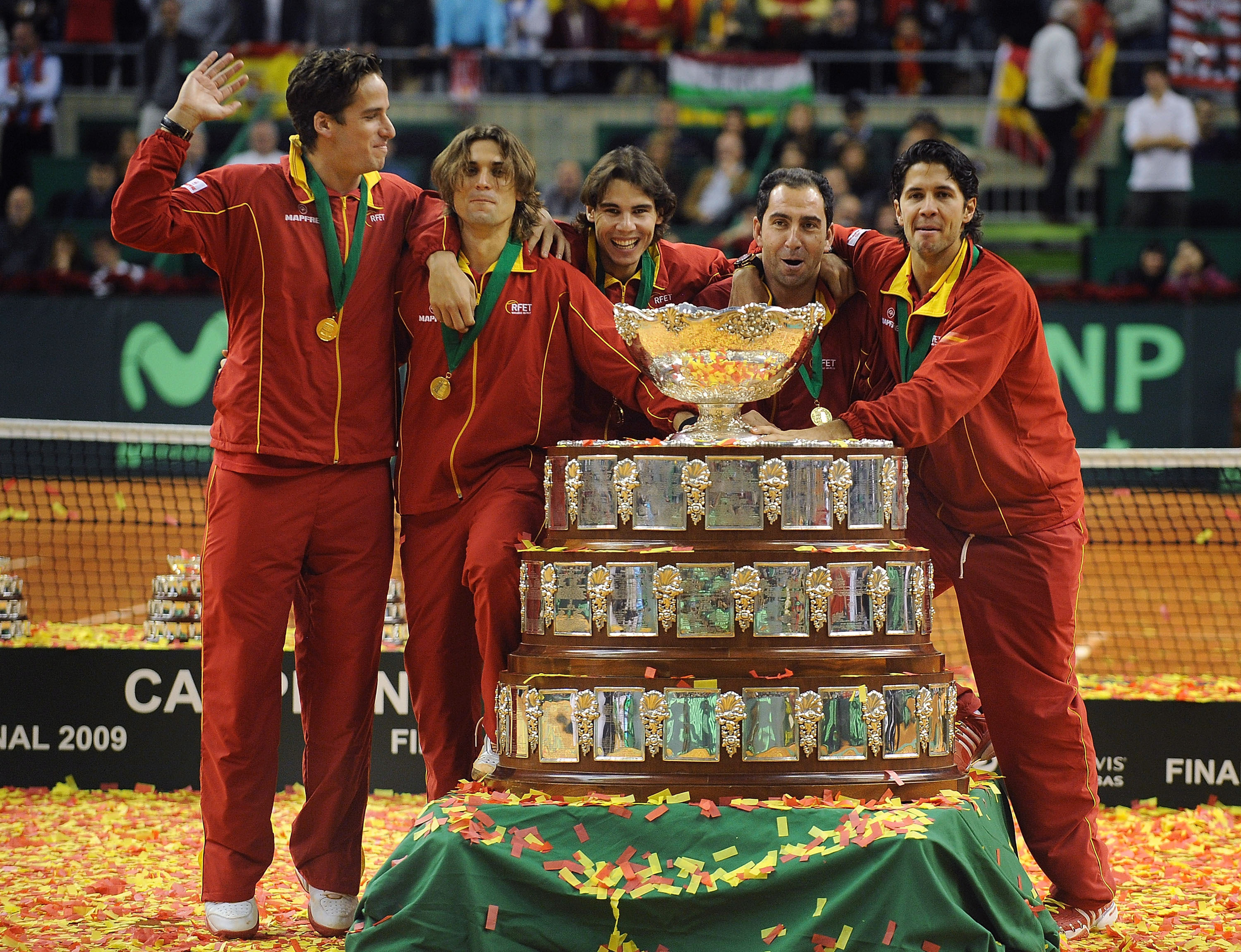 BARCELONA, SPAIN - DECEMBER 06:  Spanish players Feliciano Lopez (L), David Ferrer (C), Rafael Nadal, team captain Albert Costa and Fernando Verdasco celebrate with the Davis Cup trophy at the end of the final match between Spain and Czech Republic at the