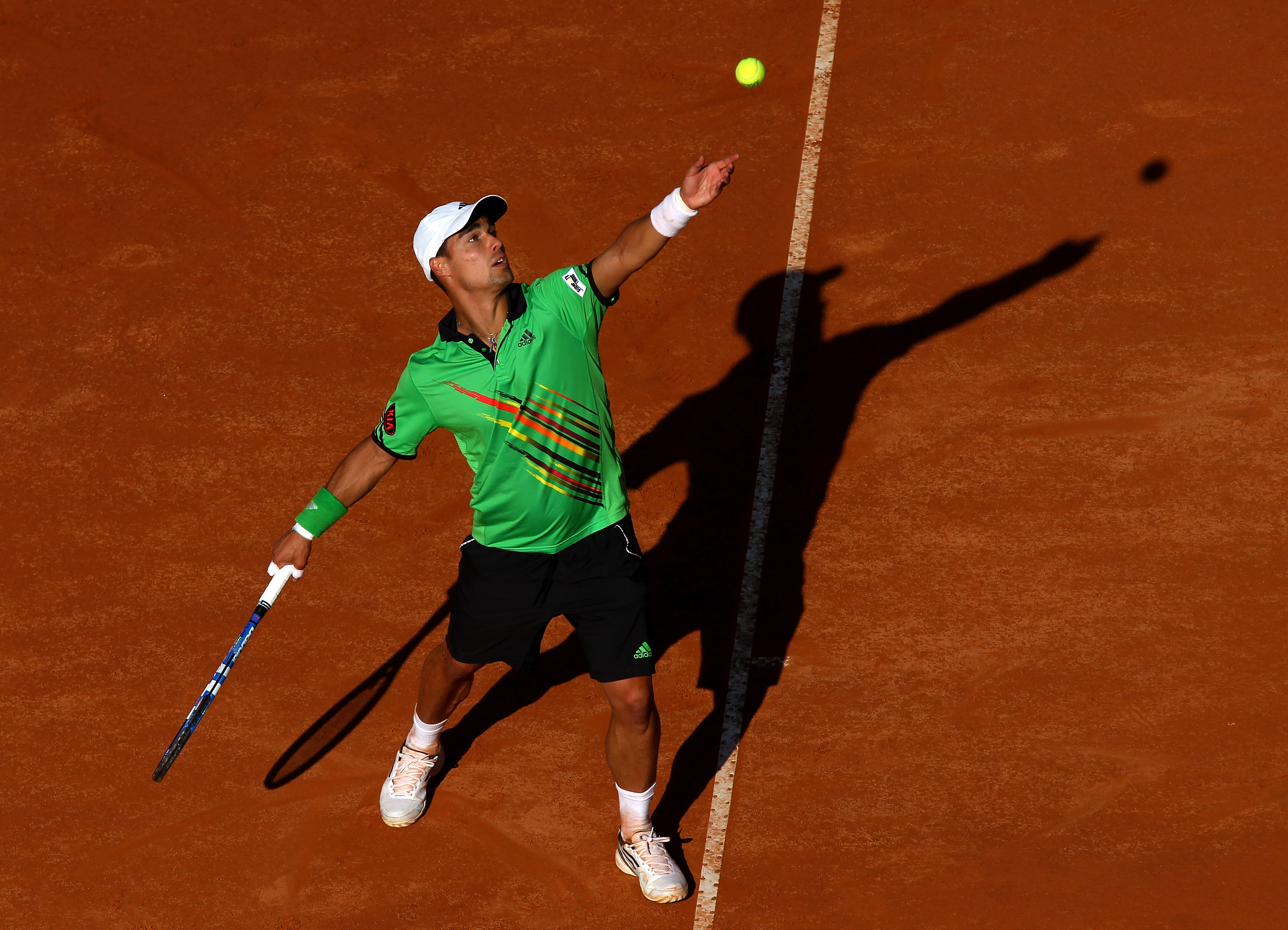 ROME, ITALY - MAY 10:  Fabio Fognini of Italy serves during his first round match against Stanislav Wawrinka of Switzerland during day three of the Internazionali BNL d'Italia at the Foro Italico Tennis Centre on May 10, 2011 in Rome, Italy.  (Photo by Al