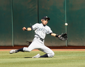 OAKLAND, CA - SEPTEMBER 06:  Ichiro Suzuki #51 of the Seattle Mariners makes a diving catch during their game against the Oakland Athletics at the Oakland-Alameda County Coliseum on September 6, 2010 in Oakland, California.  (Photo by Ezra Shaw/Getty Imag
