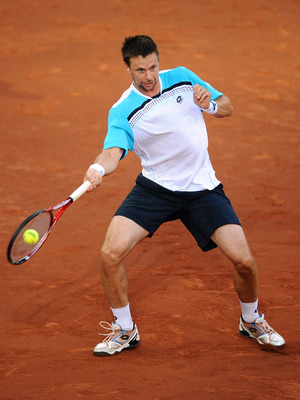 MADRID, SPAIN - MAY 06:  Robin Soderling of Sweden plays a backhand to Roger Federer of Switzerland during day seven of the Mutua Madrilena Madrid Open Tennis on May 6, 2011 in Madrid, Spain. Federer won the match in straight sets.  (Photo by Jasper Juine
