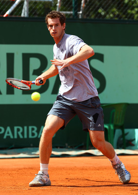 PARIS, FRANCE - MAY 22:  Andy Murray of Great Britain plays a forehand during a practice session on day one of the French Open at Roland Garros on May 22, 2011 in Paris, France.  (Photo by Clive Brunskill/Getty Images)