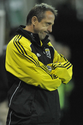 PORTLAND, OR - MAY 21: Robert Warzycha, head coach of the Columbus Crew looks on from the bench in the second half of the game against the Portland Timbers at PGE Park on May 21, 2011 in Portland, Oregon. The Timbers won the game 1-0. (Photo by Steve Dyke