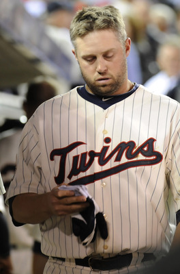 MINNEAPOLIS, MN - OCTOBER 7: Michael Cuddyer #5 of the Minnesota Twins in the dugout following a 2-5 loss to the New York Yankees in game two of the ALDS game on October 7, 2010 at Target Field in Minneapolis, Minnesota. (Photo by Hannah Foslien /Getty Im