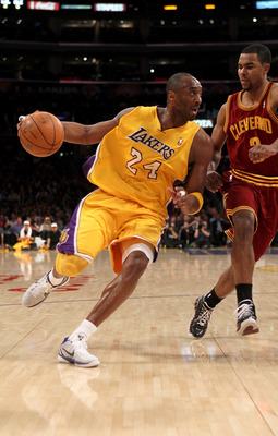 LOS ANGELES, CA - JANUARY 11:  Kobe Bryant #24 of the Los Angeles Lakers drives against Ramon Sessions #3 of the Cleveland Cavaliers at Staples Center on January 11, 2011 in Los Angeles, California.  The Lakers won 112-57.  NOTE TO USER: User expressly ac