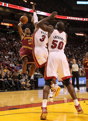 MIAMI, FL - DECEMBER 15:  Ramon Sessions #3 of the Cleveland Cavaliersshoots over Dwyane Wade #3 and  Joel Anthony #50 of the Miami Heat during a game at American Airlines Arena on December 15, 2010 in Miami, Florida. NOTE TO USER: User expressly acknowle