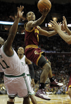 CLEVELAND - OCTOBER 27:  Ramon Sessions #3 of the Cleveland Cavaliers tries to get a shot off around Glen Davis #11 of the Boston Celtics at Quicken Loans Arena on October 27, 2010 in Cleveland, Ohio. Cleveland won the game 95-87.  (Photo by Gregory Shamu