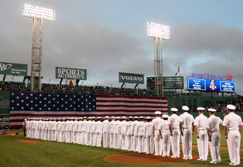 BOSTON, MA - MAY 22:  Members of all four branches of the United States military stand on the field for a pregame ceremoiney before the game between the Chicago Cubs and the Boston Red Sox on May 22, 2011 at Fenway Park in Boston, Massachusetts.  Before t