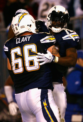SAN DIEGO - DECEMBER 28:  Runningback LaDainian Tomlinson #21 of the San Diego Chargers celebrates with teammate Jeromey Clary #66 after Tomlinson scored a 14 yard rushing touchdown against the Denver Broncos during the third quarter of the NFL game at Qu