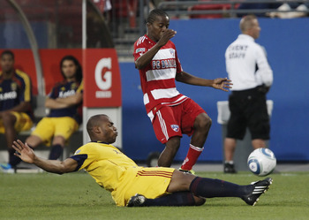 FRISCO, TX - MAY 22: Jamison Olave #4 of Real Salt Lake slide tackles the ball away from Fabian Castillo #15 of FC Dallas during the first half of a soccer game at Pizza Hut Park on May 22, 2011 in Frisco, Texas. (Photo by Brandon Wade/Getty Images)