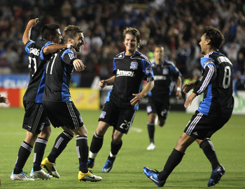 SANTA CLARA, CA - MAY 21:  Bobby Convey #11 of the San Jose Earthquakes is congratulated by teammates after he scored a goal against the New England Revolution at Buck Shaw Stadium on May 21, 2011 in Santa Clara, California.  (Photo by Ezra Shaw/Getty Ima