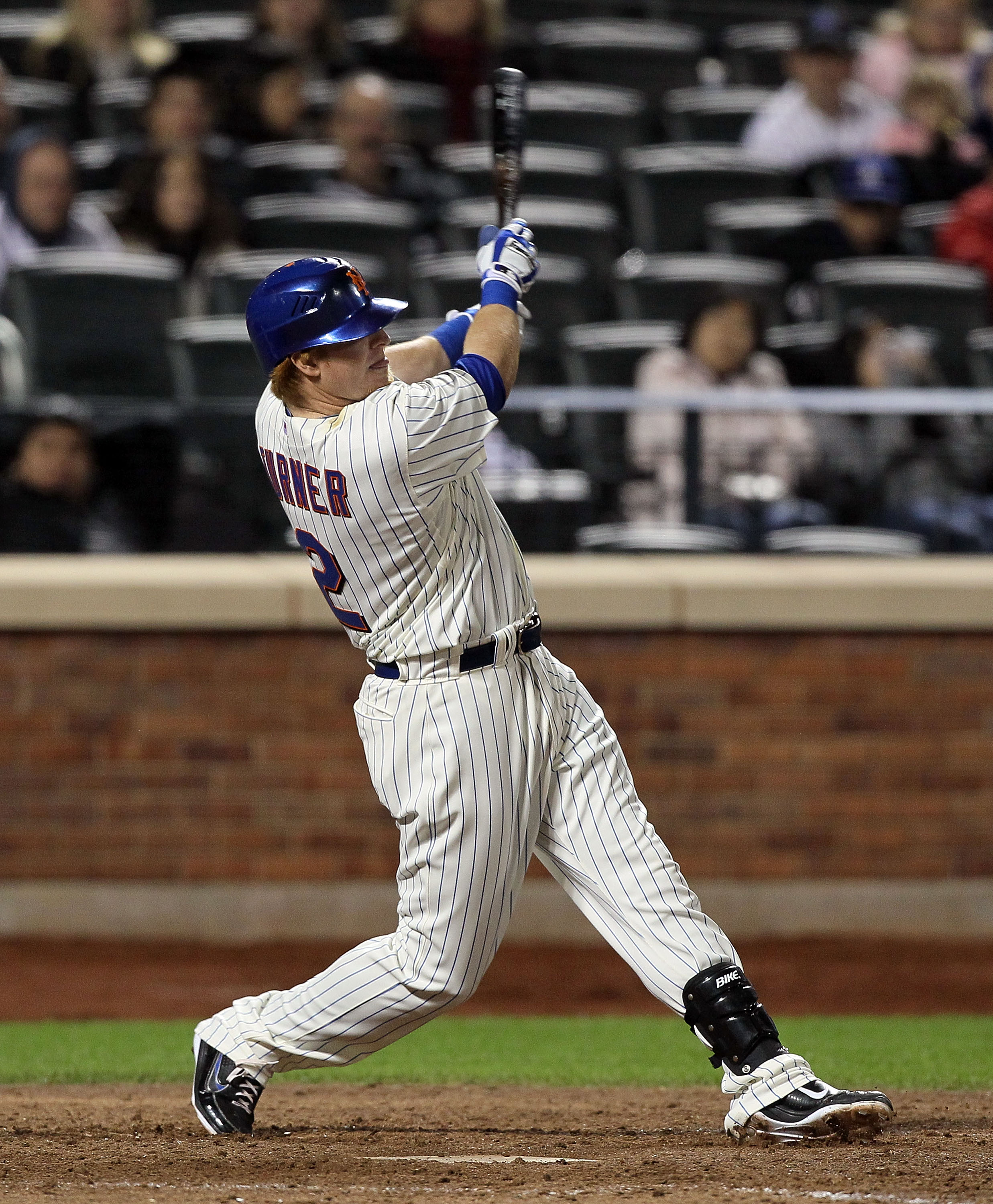 NEW YORK, NY - MAY 07:  Justin Turner #2 of the New York Mets hits an eighth inning two run single against the Los Angeles Dodgers on May 7, 2011 at Citi Field in the Flushing neighborhood of the Queens borough of New York City.  (Photo by Jim McIsaac/Get