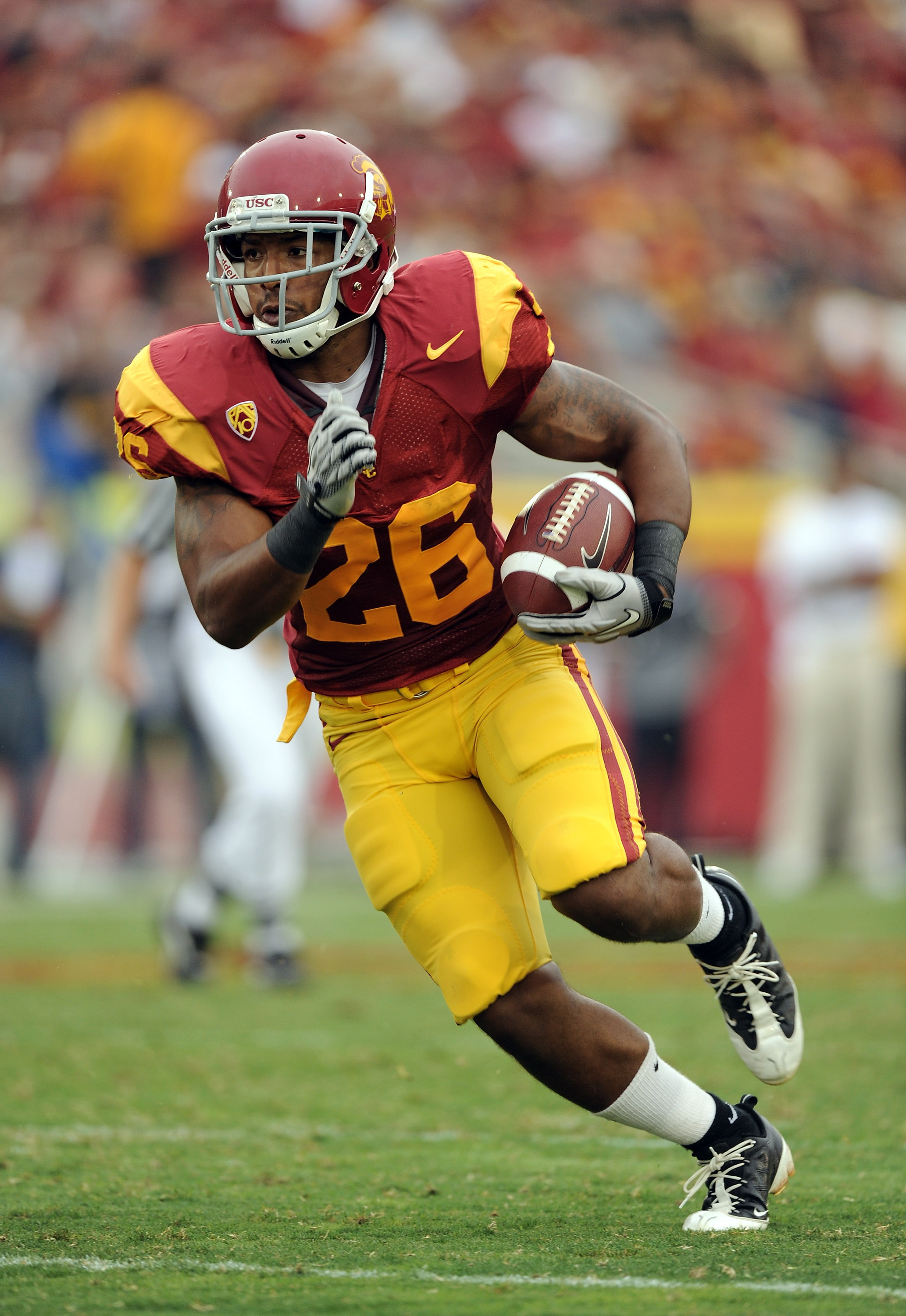 LOS ANGELES, CA - OCTOBER 16:  Marc Tyler #26 of the USC Trojans rushes the ball during the game against the California Golden Bears at Los Angeles Memorial Coliseum on October 16, 2010 in Los Angeles, California.  (Photo by Harry How/Getty Images)