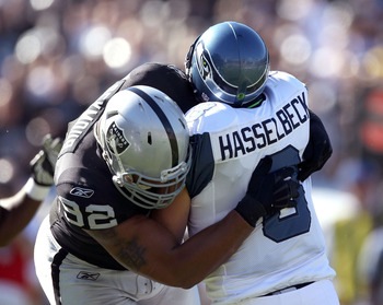 OAKLAND, CA - OCTOBER 31:  Matt Hasselbeck #8 of the Seattle Seahawks is tackled by Richard Seymour #92 of the Oakland Raiders at Oakland-Alameda County Coliseum on October 31, 2010 in Oakland, California.  (Photo by Ezra Shaw/Getty Images)
