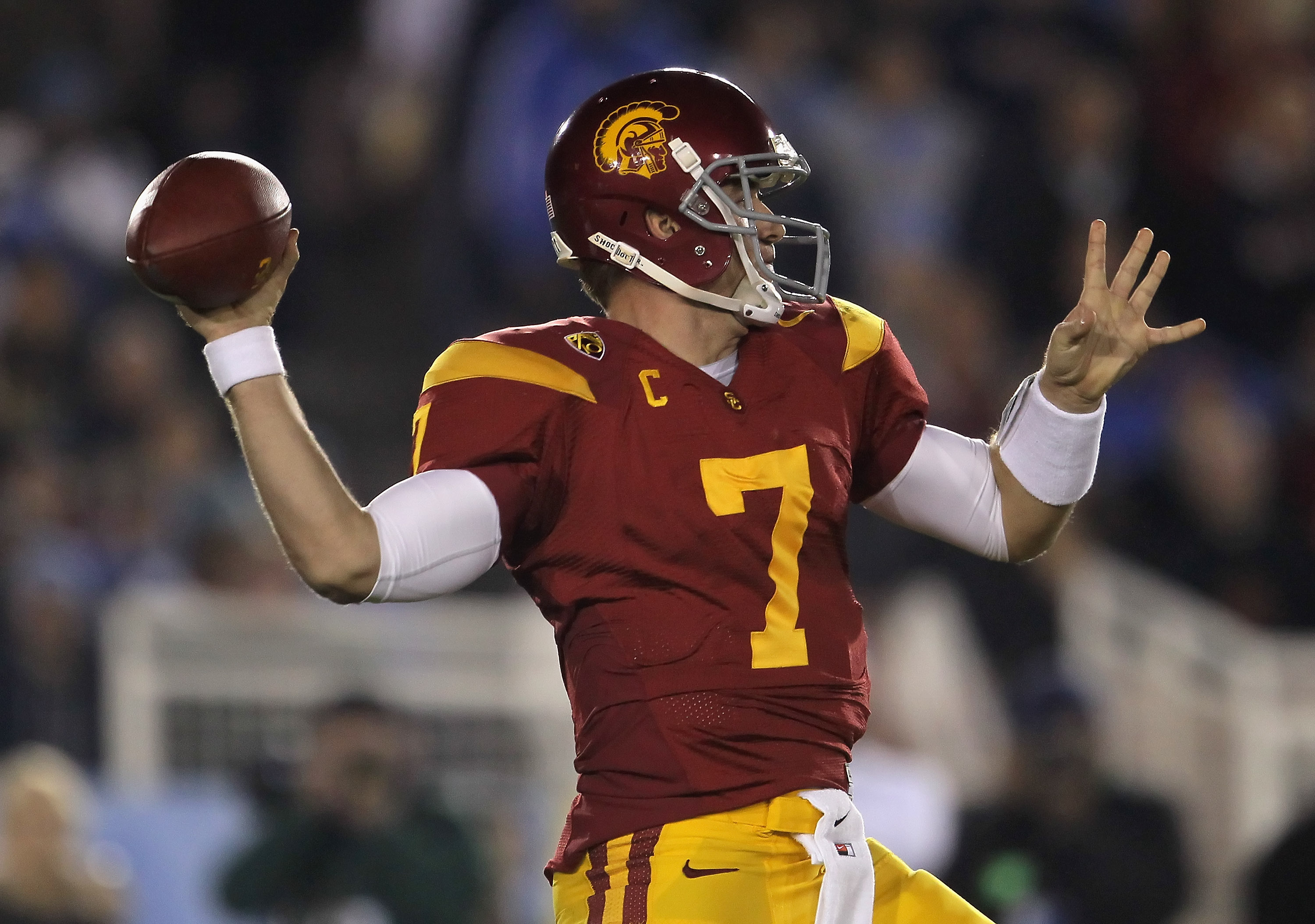 PASADENA, CA - DECEMBER 04:  Quarterback Matt Barkley #7 of the USC Trojans drops back to pass against the UCLA Bruins during the first half at the Rose Bowl on December 4, 2010 in Pasadena, California.  (Photo by Jeff Gross/Getty Images)