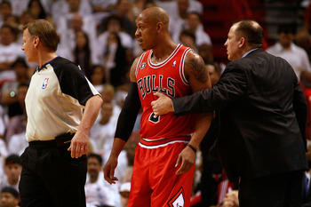 MIAMI, FL - MAY 22:  Head coach Tom Thibodeau of the Chicago Bulls holds back Keith Bogans against the Miami Heat in Game Three of the Eastern Conference Finals during the 2011 NBA Playoffs on May 22, 2011 at American Airlines Arena in Miami, Florida.  NO