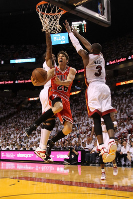 MIAMI, FL - MAY 22:  Kyle Korver #26 of the Chicago Bulls drives for a shot attempt against Dwyane Wade #3 of the Miami Heat in Game Three of the Eastern Conference Finals during the 2011 NBA Playoffs on May 22, 2011 at American Airlines Arena in Miami, F