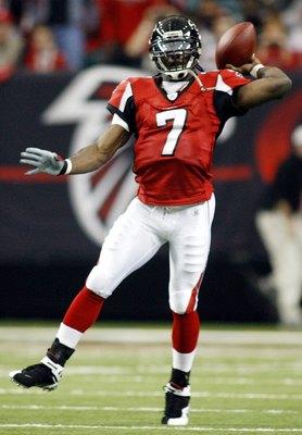 ATLANTA - DECEMBER 24:    Quarterback Michael Vick #7 of the Atlanta Falcons thows the ball against the Carolina Panthers December 24, 2006 at The Georgia Dome  in Atlanta,Georgia  (Photo by Marc Serota/Getty Images)