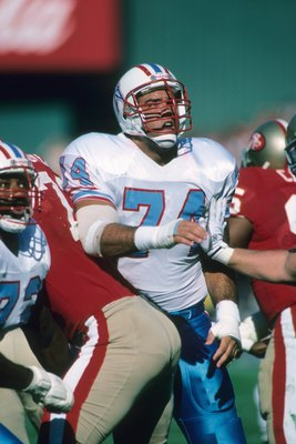 SAN FRANCISCO - NOVEMBER 8:  Guard Bruce Matthews #74 of the Houston Oilers blocks against the San Francisco 49ers defense during a game at Candlestick Park on November 8, 1987 in San Francisco, California.  The 49ers won 27-20.  (Photo by George Rose/Get