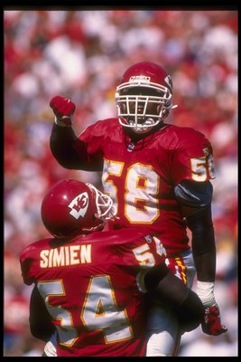 10 Sep 1995: Kansas City Chiefs linebackers Derrick Thomas (right) and Tracy Simien celebrate during a game against the New York Giants at Arrowhead Stadium in Kansas City, Missouri. The Chiefs won the game, 21-17.