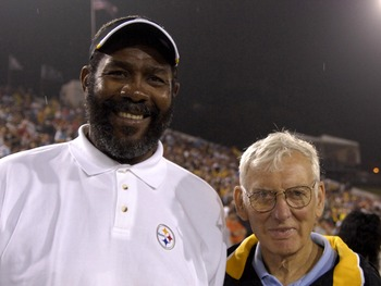 CANTON, OH - AUGUST 5:  Joe Greene and owner Dan Rooney of the Pittsburgh Steelers pose on the field during the AFC-NFC Pro Football Hall of Fame Game against the New Orleans Saints at Fawcett Stadium August 5, 2007 in Canton, Ohio.  (Photo by Al Messersc