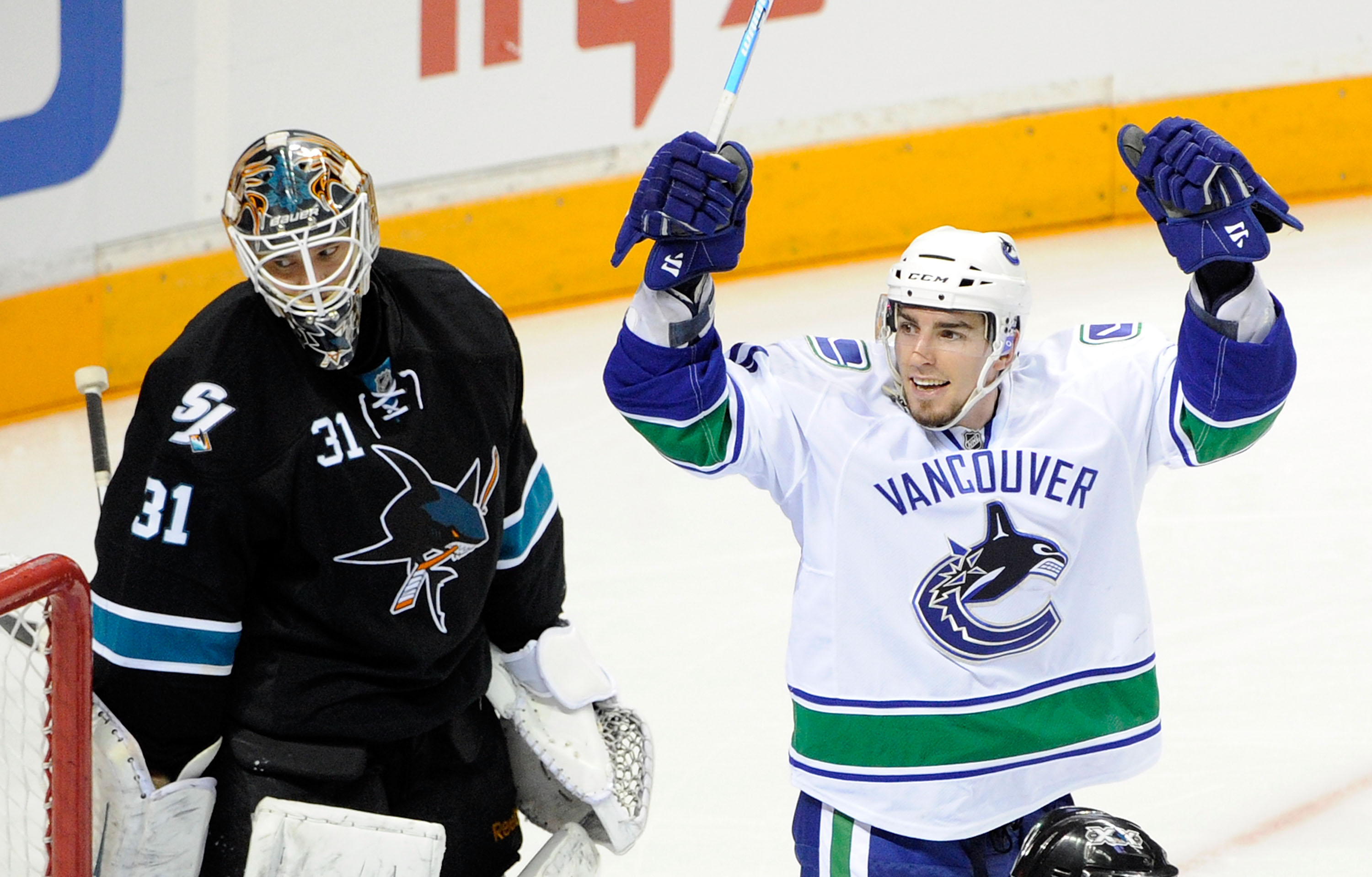 SAN JOSE, CA - MAY 22:  Alex Burrows #14 of the Vancouver Canucks celebrates after scoring in the third period as goaltender Antti Niemi #31 of the San Jose Sharks looks on in Game Four of the Western Conference Finals during the 2011 Stanley Cup Playoffs