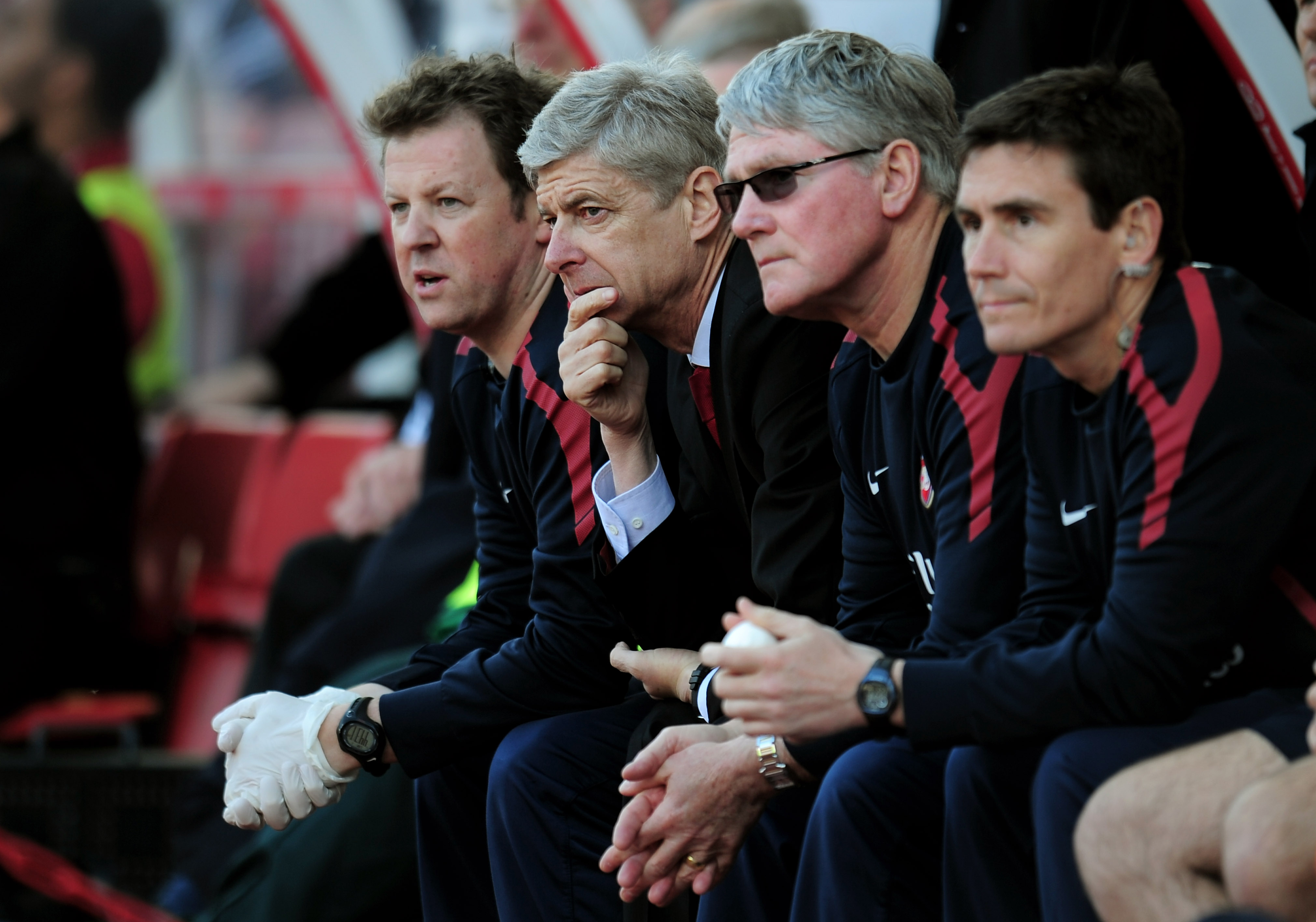 STOKE ON TRENT, ENGLAND - MAY 08:  A dejected Arsene Wenger (2nd L) the Arsenal manager looks on as his team head towards a 3-1 defeat during the Barclays Premier League match between Stoke City and Arsenal at the Britannia Stadium on May 8, 2011 in Stoke