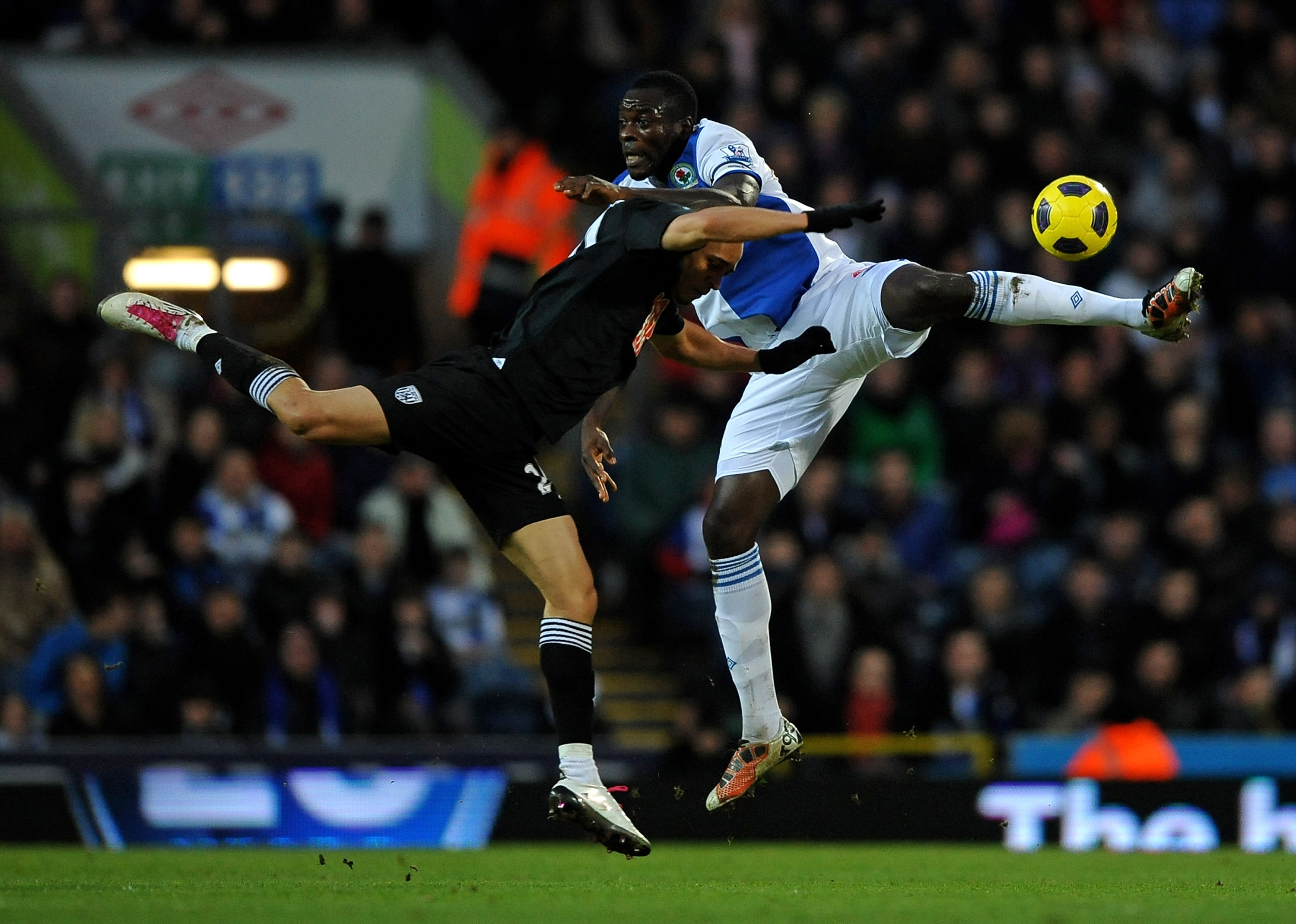 BLACKBURN, ENGLAND - JANUARY 23:  Chris Samba of Blackburn Rovers tangles with Peter Odemwingie of West Bromwich Albion during the Barclays Premier League match between Blackburn Rovers and West Bromwich Albion at Ewood Park on January 23, 2011 in Blackbu