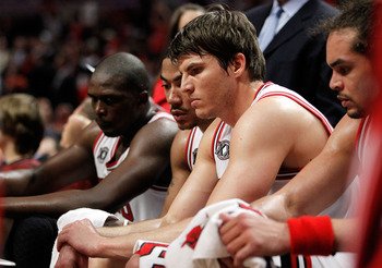 CHICAGO, IL - MAY 18:  (L-R) Luol Deng #9, Derrick Rose #1, Kyle Korver #26 and Joakim Noah #13 of the Chicago Bulls look on dejected from the bench late in the fourth quarter against the Miami Heat in Game Two of the Eastern Conference Finals during the