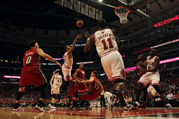 CHICAGO, IL - MAY 18:  Derrick Rose #1 of the Chicago Bulls drives for a shot attempt against Mike Miller #13 of the Miami Heat in Game Two of the Eastern Conference Finals during the 2011 NBA Playoffs on May 18, 2011 at the United Center in Chicago, Illi