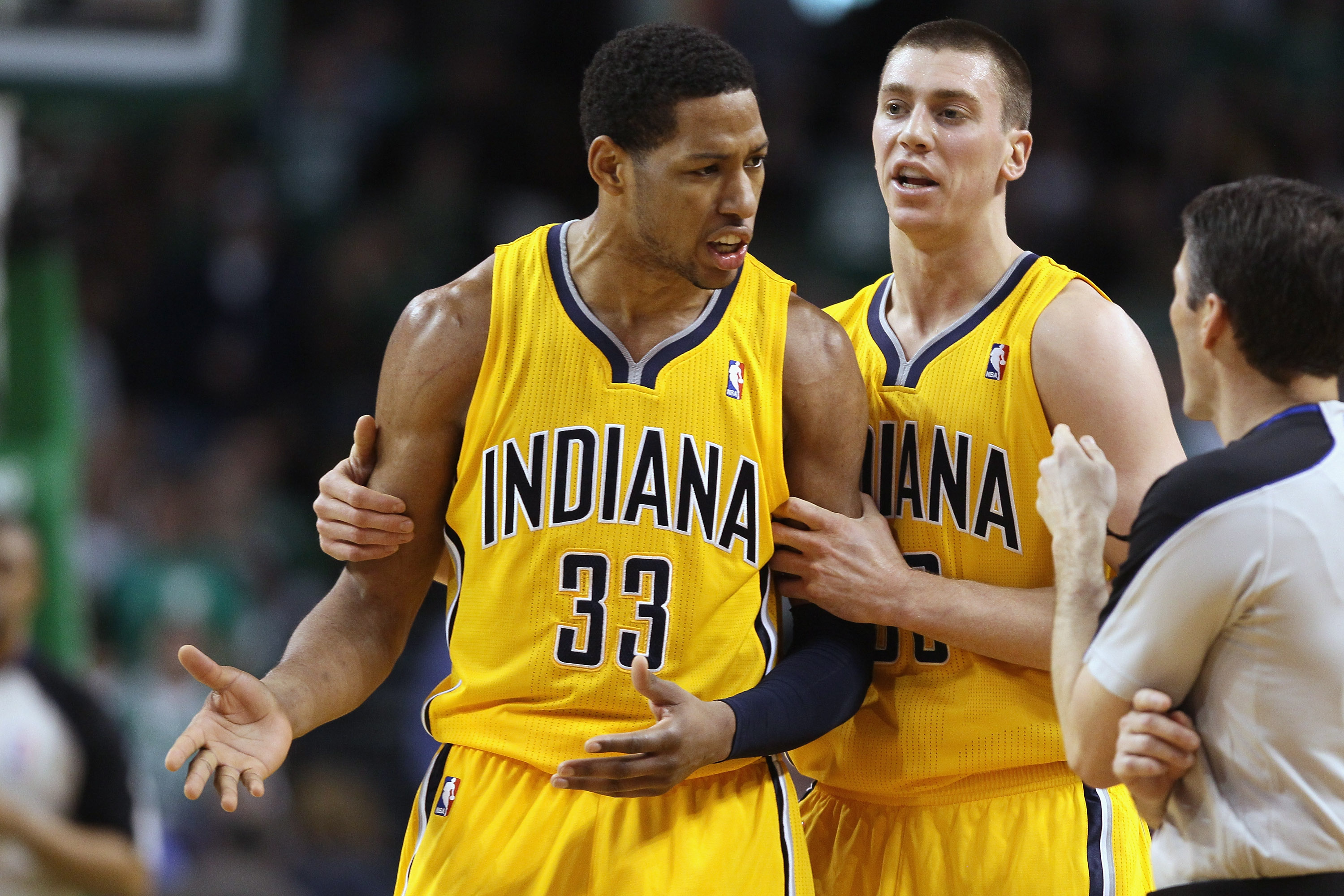 BOSTON, MA - MARCH 16:  Danny Granger #33 is pulled away from the referee by teamamte Tyler Hansbrough #50 of the Indiana Pacers on March 16, 2011 at the TD Garden in Boston, Massachusetts. Granger was called for a techical foul. The Celtics defeated the